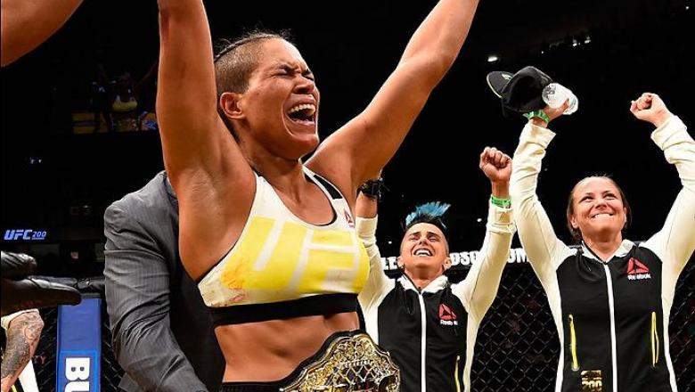 LAS VEGAS, NV - JULY 09: Amanda Nunes of Brazil reacts to her victory over Miesha Tate in their UFC women's bantamweight championship bout during the UFC 200 event on July 9, 2016 at T-Mobile Arena in Las Vegas, Nevada.  (Photo by Josh Hedges/Zuffa LLC/Zu