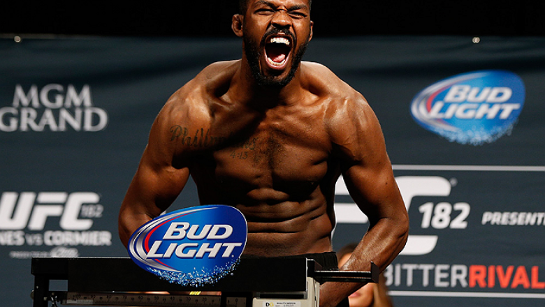 "LAS VEGAS, NV - JANUARY 02:  UFC light heavyweight champion Jon ""Bones"" Jones poses on the scale after weighing in during the UFC 182 weigh-in event at the MGM Grand Conference Center on January 2, 2015 in Las Vegas, Nevada. (Photo by Josh Hedges/Zuffa LL"