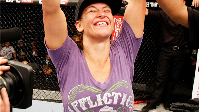 SAITAMA, JAPAN - SEPTEMBER 20:  Miesha Tate celebrates after her win over Rin Nakai in their bantamweight bout during the UFC Fight Night event inside the Saitama Arena on September 20, 2014 in Saitama, Japan. (Photo by Mitch Viquez/Zuffa LLC/Zuffa LLC vi
