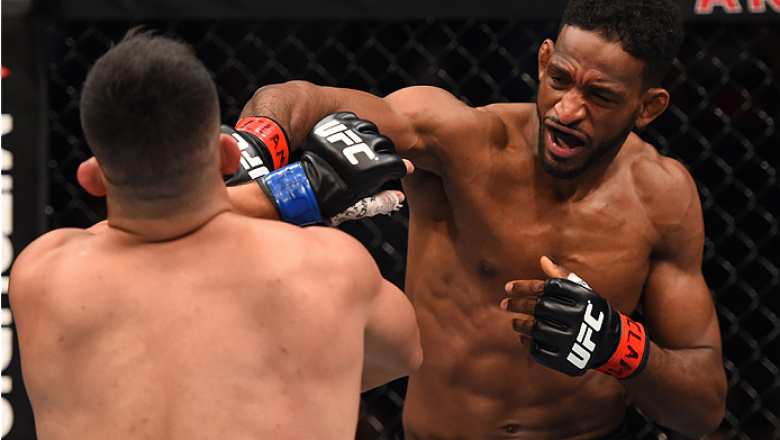 MONTERREY, MEXICO - NOVEMBER 21:  (R-L) Neil Magny of the United States punches Kelvin Gastelum of the United States in their welterweight bout during the UFC Fight Night event at Arena Monterrey on November 21, 2015 in Monterrey, Mexico.  (Photo by Jeff