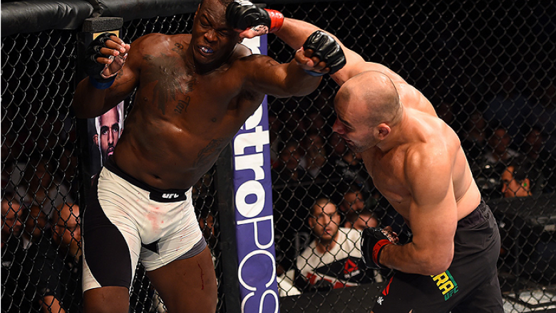 NASHVILLE, TN - AUGUST 08:  (R-L) Glover Teixeira of Brazil punches Ovince Saint Preux in their light heavyweight bout during the UFC Fight Night event at Bridgestone Arena on August 8, 2015 in Nashville, Tennessee.  (Photo by Josh Hedges/Zuffa LLC/Zuffa