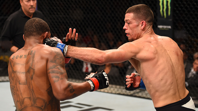 ORLANDO, FL - DECEMBER 19:   (R-L) Nate Diaz punches Michael Johnson in their lightweight bout during the UFC Fight Night event at the Amway Center on December 19, 2015 in Orlando, Florida. (Photo by Josh Hedges/Zuffa LLC/Zuffa LLC via Getty Images)