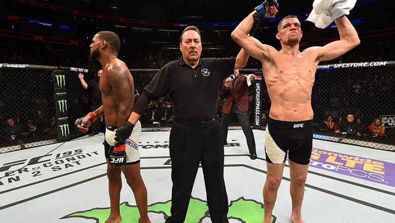 ORLANDO, FL - DECEMBER 19:   (R-L) Nate Diaz celebrates his victory over Michael Johnson in their lightweight bout during the UFC Fight Night event at the Amway Center on December 19, 2015 in Orlando, Florida. (Photo by Josh Hedges/Zuffa LLC/Zuffa LLC via