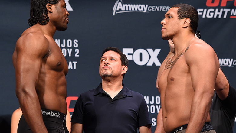 ORLANDO, FL - DECEMBER 18:   (L-R) Opponents Francis Ngannou of France and Luis Henrique of Brazil face off during the UFC weigh-in at the Orange County Convention Center on December 18, 2015 in Orlando, Florida. (Photo by Josh Hedges/Zuffa LLC/Zuffa LLC