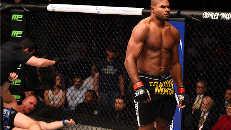 PHOENIX, AZ - DECEMBER 13:  (R-L) Alistair Overeem of the Netherlands walks away from Stefan Struve of the Netherlands after defeating him in their heavyweight fight during the UFC Fight Night event at the U.S. Airways Center on December 13, 2014 in Phoen