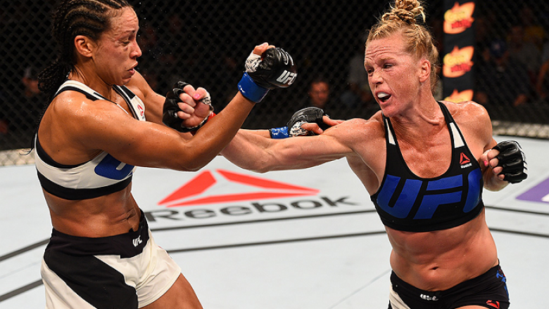 SAN DIEGO, CA - JULY 15:   (R-L) Holly Holm punches Marion Reneau in their women's bantamweight bout during the UFC event at the Valley View Casino Center on July 15, 2015 in San Diego, California. (Photo by Jeff Bottari/Zuffa LLC/Zuffa LLC via Getty Imag