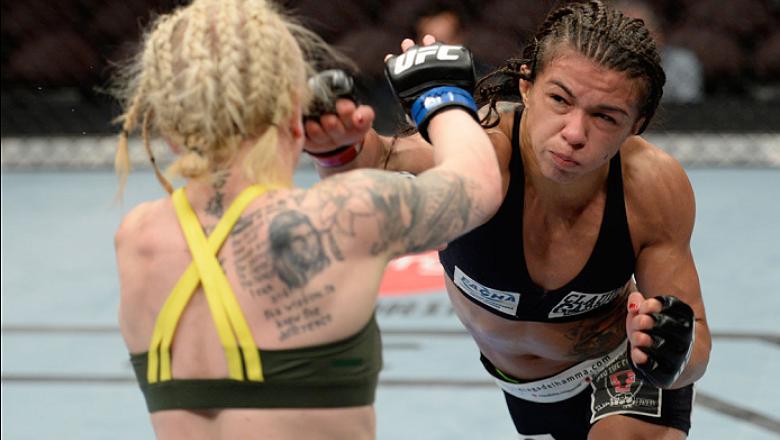 ATLANTIC CITY, NJ - JULY 16: (R-L) Claudia Gadelha punches Tina Lahdemaki in their women's strawweight bout during the UFC Fight Night event at Revel Casino on July 16, 2014 in Atlantic City, New Jersey. (Photo by Jeff Bottari/Zuffa LLC/Zuffa LLC via Gett