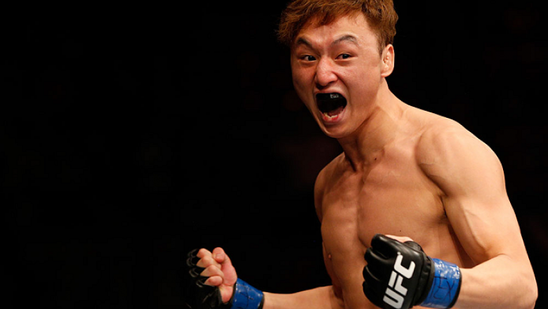 AUSTIN, TX - NOVEMBER 22:  Doo Ho Choi of South Korea celebrates after his TKO victory over Juan Puig of Mexico in their featherweight bout during the UFC Fight Night event at The Frank Erwin Center on November 22, 2014 in Austin, Texas.  (Photo by Josh H