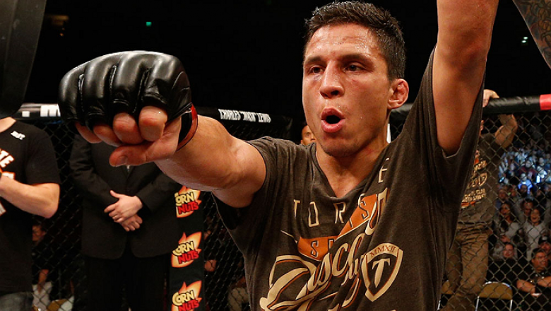 AUSTIN, TX - NOVEMBER 22:  Joseph Benavidez celebrates after his unanimous-decision victory over Dustin Ortiz in their flyweight bout during the UFC Fight Night event at The Frank Erwin Center on November 22, 2014 in Austin, Texas.  (Photo by Josh Hedges/
