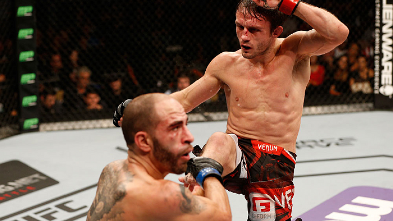 AUSTIN, TX - NOVEMBER 22:  (R-L) Brad Pickett of England kicks Chico Camus in their flyweight bout during the UFC Fight Night event at The Frank Erwin Center on November 22, 2014 in Austin, Texas.  (Photo by Josh Hedges/Zuffa LLC/Zuffa LLC via Getty Image