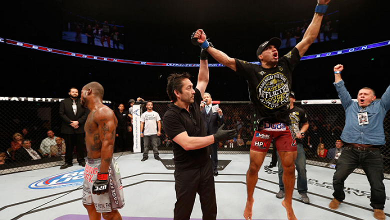 AUSTIN, TX - NOVEMBER 22:  Edson Barboza of Brazil celebrates after his unanimous-decision victory over Bobby Green in their lightweight bout during the UFC Fight Night event at The Frank Erwin Center on November 22, 2014 in Austin, Texas.  (Photo by Josh