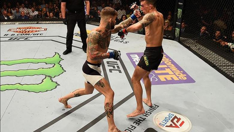 LAS VEGAS, NV - MAY 29:  (L-R) Cody Garbrandt punches Thomas Almeida of Brazil in their bantamweight bout during the UFC Fight Night event inside the Mandalay Bay Events Center on May 29, 2016 in Las Vegas, Nevada.  (Photo by Josh Hedges/Zuffa LLC/Zuffa L