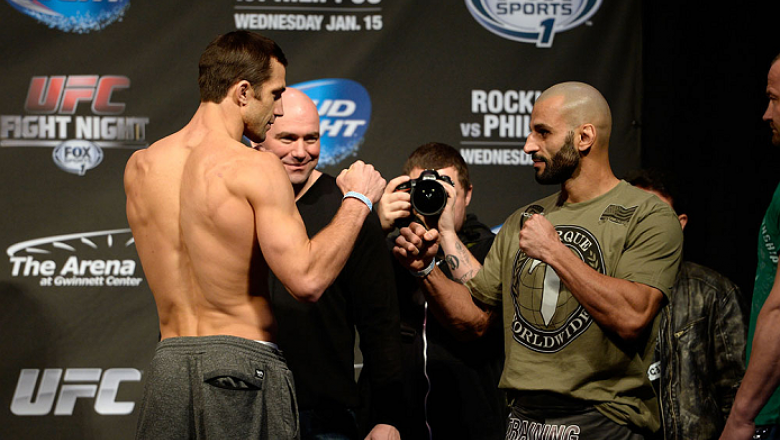 DULUTH, GEORGIA - JANUARY 14:  (L-R) Luke Rockhold and Costas Philippou face off during the UFC Fight Night weigh-in event at the Arena at Gwinnett Center on January 14, 2014 in Duluth, Georgia. (Photo by Jeff Bottari/Zuffa LLC/Zuffa LLC via Getty Images)