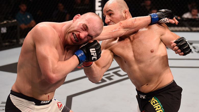 SAO PAULO, BRAZIL - NOVEMBER 07:  Glover Teixeira of Brazil punches Patrick Cummins of the United States in their light heavyweight bout during the UFC Fight Night Belfort v Henderson at Ibirapuera Gymnasium on November 7, 2015 in Sao Paulo, Brazil.  (Pho