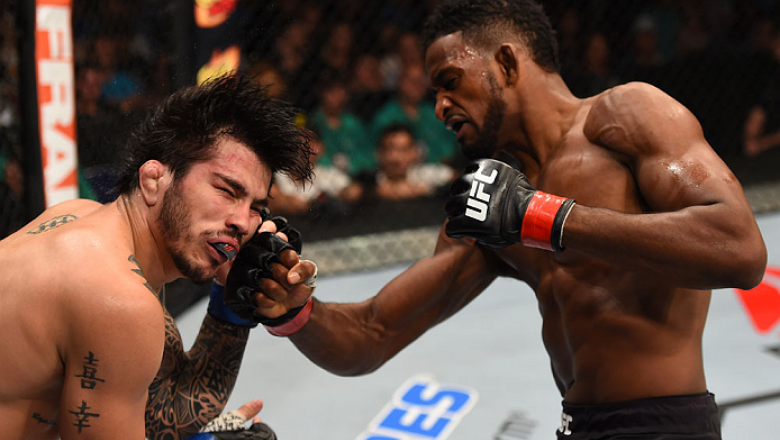 SASKATOON, SK - AUGUST 23:  (R-L) Neil Magny of the United States punches Erick Silva of Brazil in their welterweight bout during the UFC event at the SaskTel Centre on August 23, 2015 in Saskatoon, Saskatchewan, Canada. (Photo by Jeff Bottari/Zuffa LLC/Z