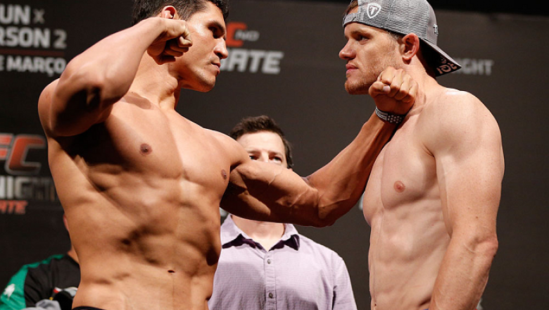 """NATAL, BRAZIL - MARCH 22:  (L-R) Opponents Cezar """"Mutante"""" Ferreira and CB Dollaway face off during the UFC weigh-in at Ginasio Nelio Dias on March 22, 2014 in Natal, Brazil. (Photo by Josh Hedges/Zuffa LLC/Zuffa LLC via Getty Images)"""