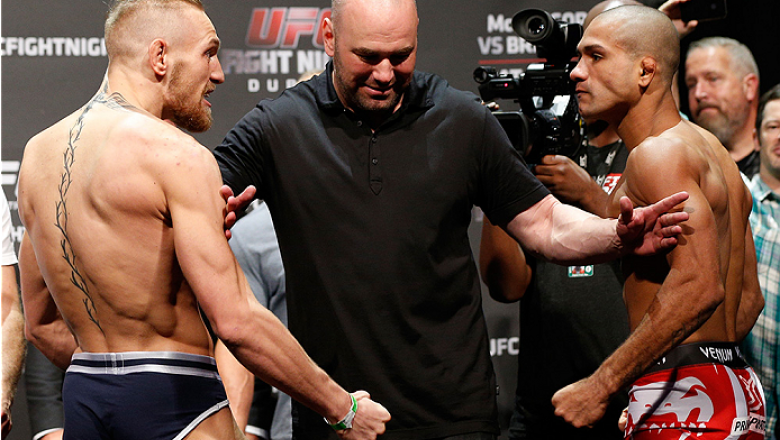 DUBLIN, IRELAND - JULY 18:  Opponents Conor McGregor (L) and Diego Brandao (R) are separated by UFC President Dana White during the UFC weigh-in event at The O2 on July 18, 2014 in Dublin, Ireland.  (Photo by Josh Hedges/Zuffa LLC/Zuffa LLC via Getty Imag