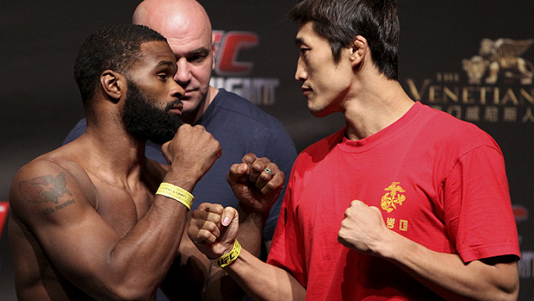 MACAU - AUGUST 22:  (L and R) Tyron Woodley and Dong Hyun Kim during the UFC weigh-in event at the Venetian Macau on August 22, 2014 in Macau, Macau.. (Photo by Mitch Viquez/Zuffa LLC/Zuffa LLC via Getty Images)
