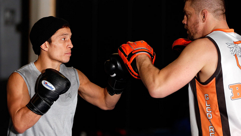 SACRAMENTO, CA - DECEMBER 11:  (L-R) Joseph Benavidez works out with head coach Duane Ludwig during an open training session for media at Ultimate Fitness on December 11, 2013 in Sacramento, California. (Photo by Josh Hedges/Zuffa LLC/Zuffa LLC via Getty