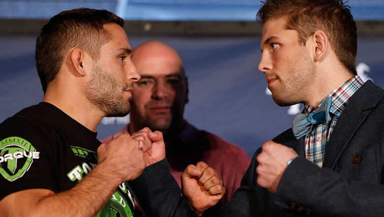 SACRAMENTO, CA - DECEMBER 12:  (L-R) Opponents Chad Mendes and Nik Lentz face off during the final pre-fight press conference before the UFC on FOX event at Sleep Train Arena on December 12, 2013 in Sacramento, California. (Photo by Josh Hedges/Zuffa LLC/