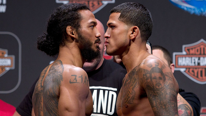 MILWAUKEE, WI - AUGUST 30:  (L-R) Benson Henderson squares off against Anthony Pettis during the UFC 164 weigh-in inside the BMO Harris Bradley Center on August 30, 2013 in Milwaukee, Wisconsin. (Photo by Ed Mulholland/Zuffa LLC/Zuffa LLC via Getty Images