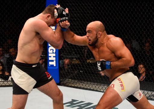 Ilir Latifi punches Gian Villante in their light heavyweight bout during the UFC 196 event inside MGM Grand Garden Arena on March 5, 2016 in Las Vegas, Nevada.