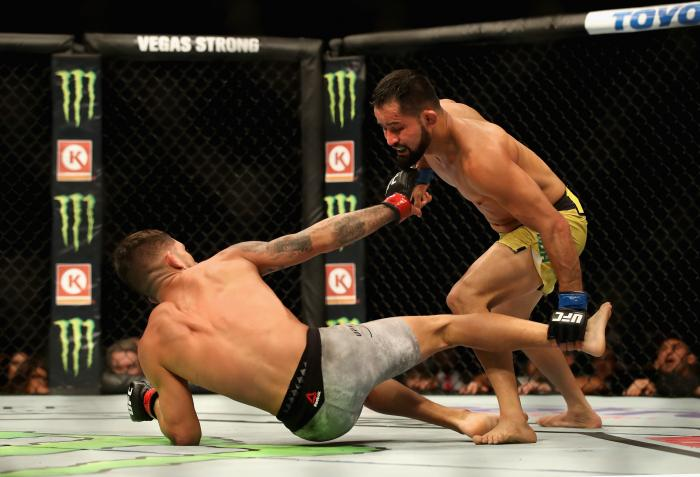 Jussier Formiga stands over Sergio Pettis in their flyweight bout during the UFC 229 event inside T-Mobile Arena on October 6, 2018 in Las Vegas, Nevada.