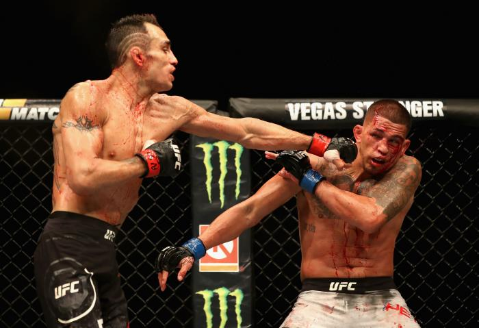 Tony Ferguson punches Anthony Pettis in their lightweight bout during the UFC 229 event inside T-Mobile Arena on October 6, 2018 in Las Vegas, Nevada.