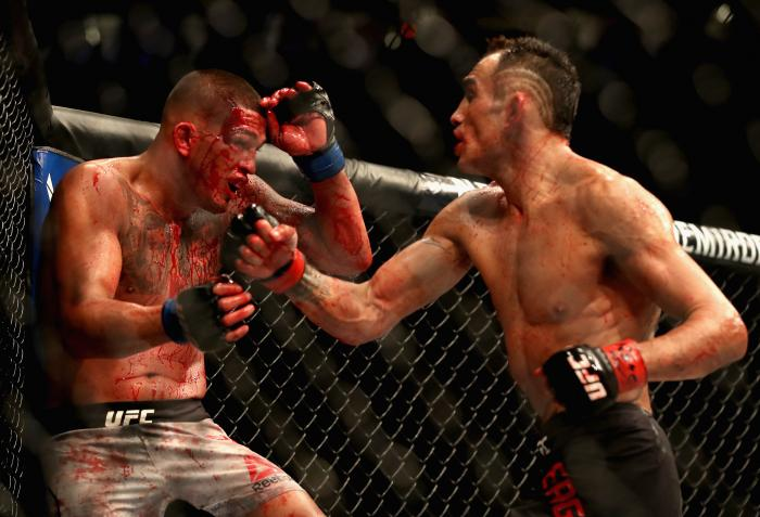 Tony Ferguson throws a punch at Anthony Pettis in their lightweight bout during the UFC 229 event inside T-Mobile Arena on October 6, 2018 in Las Vegas, Nevada.