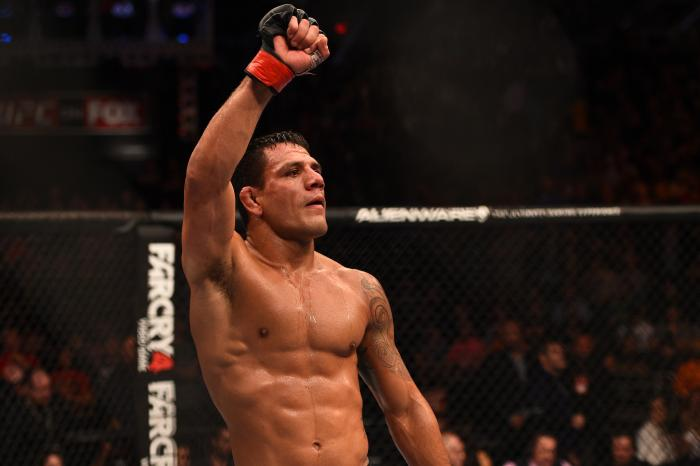 PHOENIX, AZ - DECEMBER 13: Rafael dos Anjos of Brazil celebrates after defeating Nate Diaz in their lightweight fight during the UFC Fight Night event at the U.S. Airways Center on December 13, 2014 in Phoenix, Arizona. (Photo by Josh Hedges/Zuffa LLC/Zuffa LLC via Getty Images)