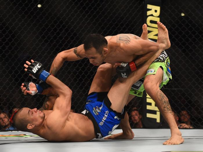 Tony Ferguson punches Gleison Tibau in their lightweight bout during the UFC 184 event at Staples Center on February 28, 2015 in Los Angeles, California.