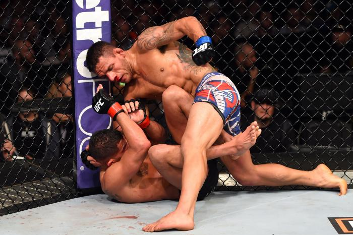 DALLAS, TX - MARCH 14: (R-L) Rafael dos Anjos of Brazil controls the body of Anthony Pettis in their UFC lightweight championship bout during the UFC 185 event at the American Airlines Center on March 14, 2015 in Dallas, Texas. (Photo by Josh Hedges/Zuffa LLC/Zuffa LLC via Getty Images)
