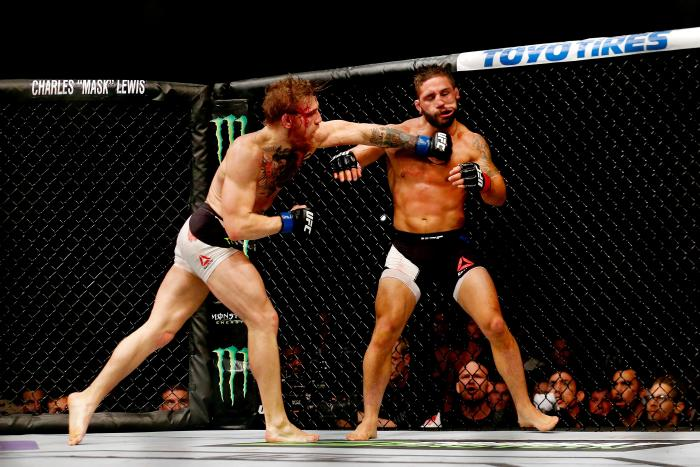 LAS VEGAS, NV - JULY 11: (L-R) Conor McGregor punches Chad Mendes in their UFC interim featherweight title fight during the UFC 189 event inside MGM Grand Garden Arena on July 11, 2015 in Las Vegas, Nevada. (Photo by Christian Petersen/Zuffa LLC/Zuffa LLC via Getty Images)