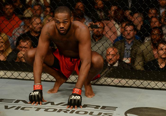 """BALTIMORE, MD - APRIL 26: Jon """"Bones"""" Jones crouches in the Octagon before his light heavyweight championship bout against Glover Teixeira during the UFC 172 event at the Baltimore Arena on April 26, 2014 in Baltimore, Maryland. (Photo by Patrick Smith/Zuffa LLC via Getty Images)"""