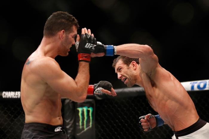 LAS VEGAS, NV - DECEMBER 12: (R-L) Luke Rockhold punches Chris Weidman in their UFC middleweight championship bout during the UFC 194 event inside MGM Grand Garden Arena on December 12, 2015 in Las Vegas, Nevada. (Photo by Christian Petersen/Zuffa LLC/Zuffa LLC via Getty Images)