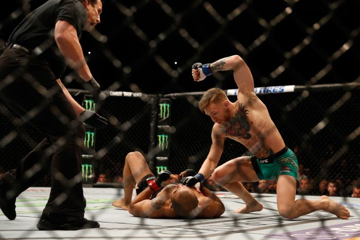 LAS VEGAS, NV - DECEMBER 12: Conor McGregor of Ireland (top) punches Jose Aldo of Brazil in their UFC featherweight championship bout during the UFC 194 event inside MGM Grand Garden Arena on December 12, 2015 in Las Vegas, Nevada. (Photo by Christian Petersen/Zuffa LLC/Zuffa LLC via Getty Images)