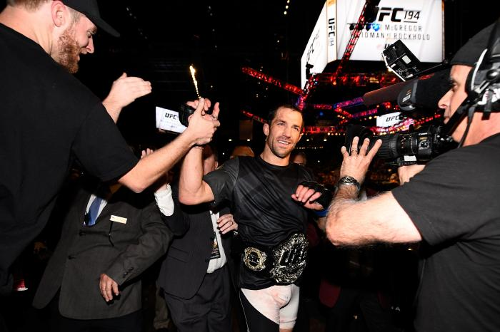 LAS VEGAS, NEVADA - DECEMBER 12: UFC middleweight champion Luke Rockhold celebrates withs fans after defeating Chris Weidman in their middleweight championship bout during the UFC 194 event inside MGM Grand Garden Arena on December 12, 2015 in Las Vegas, Nevada. (Photo by Jeff Bottari/Zuffa LLC/Zuffa LLC via Getty Images)