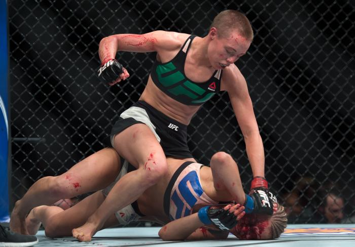 LAS VEGAS, NEVADA - DECEMBER 10:  (Top) Rose Namajunas punches Paige VanZant in their women's strawweight bout during the UFC Fight Night event at The Chelsea at the Cosmopolitan of Las Vegas on December 10, 2015 in Las Vegas, Nevada.  (Photo by Brandon Magnus/Zuffa LLC via Getty Images)