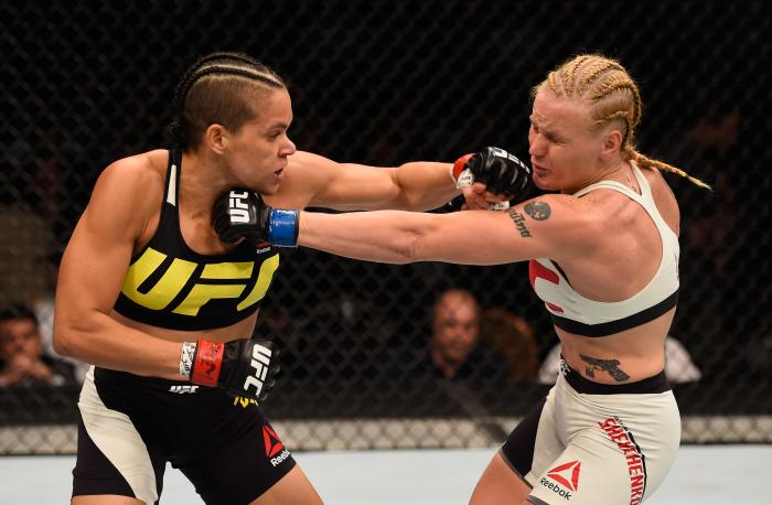 Amanda Nunes punches Valentina Shevchenko in their women's bantamweight bout during the UFC 196 event inside MGM Grand Garden Arena on March 5, 2016 in Las Vegas, Nevada.