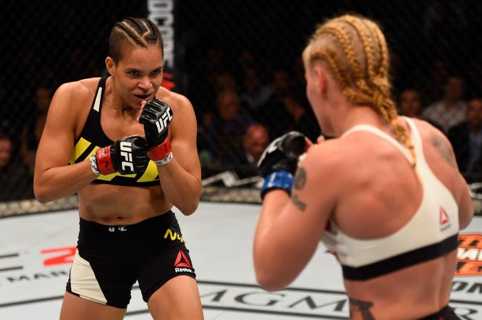 Amanda Nunes stands in front of Valentina Shevchenko in their women's bantamweight bout during the UFC 196 event inside MGM Grand Garden Arena on March 5, 2016 in Las Vegas, Nevada.
