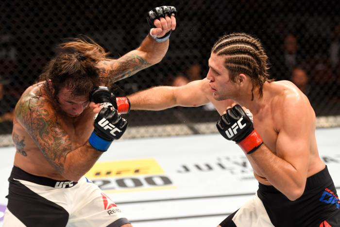 Brian Ortega punches Clay Guida in their featherweight bout during the UFC 199 event at The Forum on June 4, 2016 in Inglewood, California.