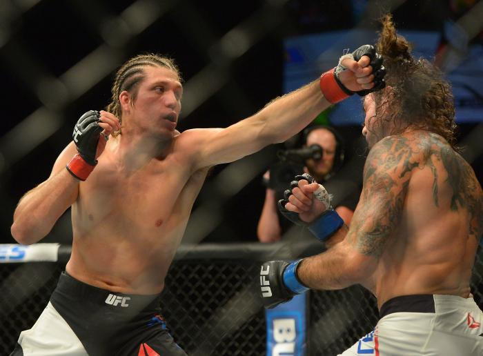 Brian Ortega punches Clay Guida at The Forum on June 4, 2016 in Inglewood, California.