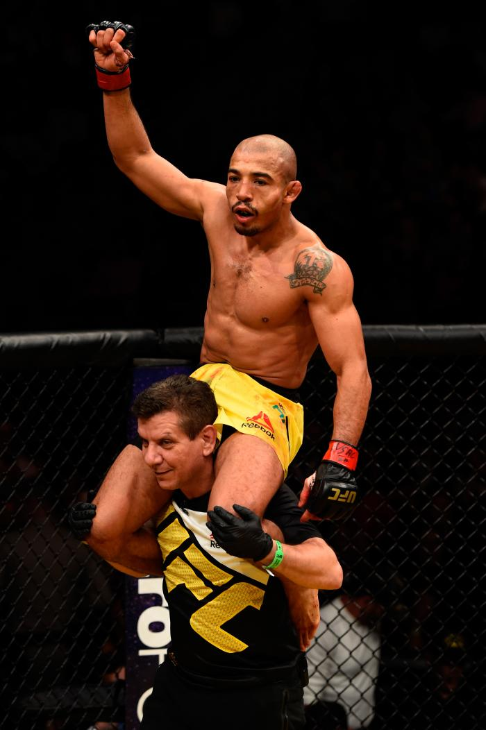 Jose Aldo celebrates after fighting Frankie Edgar in their UFC interim featherweight championship bout during the UFC 200 event on July 9, 2016 at T-Mobile Arena in Las Vegas, Nevada.