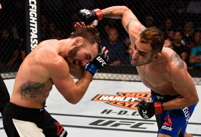 SIOUX FALLS, SD - JULY 13:   (R-L) Tony Ferguson punches Lando Vannat in their lightweight bout during the UFC Fight Night event on July 13, 2016 at Denny Sanford Premier Center in Sioux Falls, South Dakota. (Photo by Jeff Bottari/Zuffa LLC via Getty Images)
