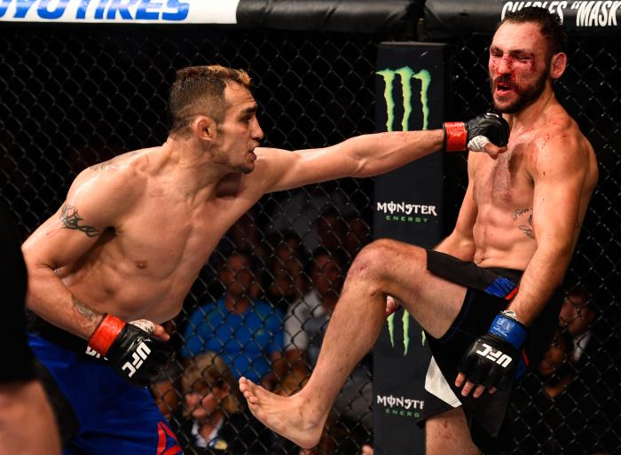 SIOUX FALLS, SD - JULY 13:   (L-R) Tony Ferguson punches Lando Vannat in their lightweight bout during the UFC Fight Night event on July 13, 2016 at Denny Sanford Premier Center in Sioux Falls, South Dakota. (Photo by Jeff Bottari/Zuffa LLC via Getty Images)
