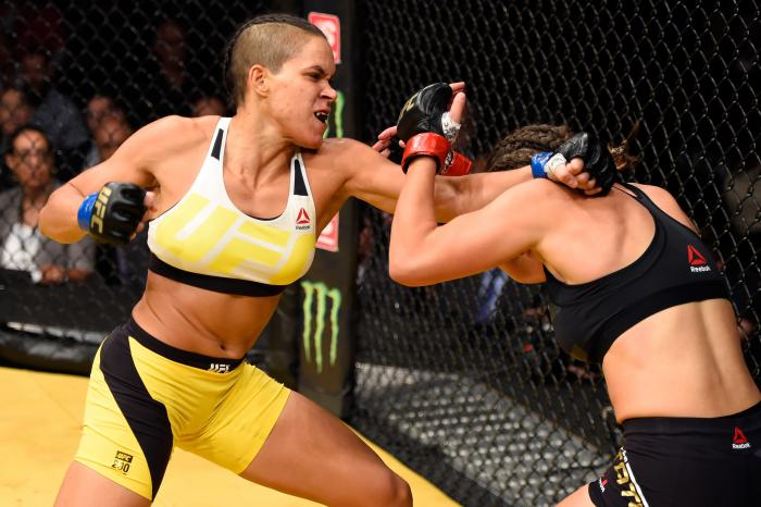 LAS VEGAS, NV - JULY 09:  (L-R) Amanda Nunes of Brazil punches Miesha Tate in their UFC women's bantamweight championship bout during the UFC 200 event at T-Mobile Arena on July 9, 2016 in Las Vegas, Nevada. (Photo by Josh Hedges/Zuffa LLC/Zuffa LLC via Getty Images)