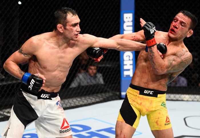 MEXICO CITY, MEXICO - NOVEMBER 05:  (L-R) Tony Ferguson of the United States punches Rafael Dos Anjos of Brazil in their lightweight bout during the UFC Fight Night event at Arena Ciudad de Mexico on November 5, 2016 in Mexico City, Mexico. (Photo by Jeff Bottari/Zuffa LLC via Getty Images)