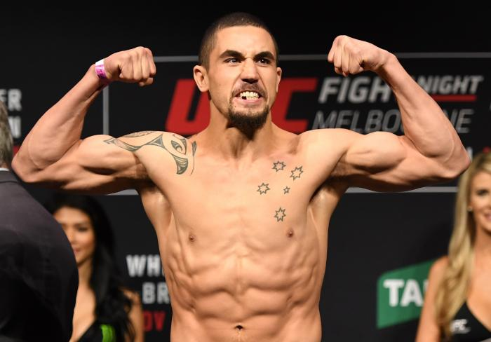 MELBOURNE, AUSTRALIA - NOVEMBER 26: Robert Whittaker of New Zealand poses on the scale during the UFC weigh-in at Rod Laver Arena on November 26, 2016 in Melbourne, Australia. (Photo by Jeff Bottari/Zuffa LLC via Getty Images)