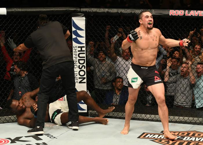 MELBOURNE, AUSTRALIA - NOVEMBER 27: Robert Whittaker of New Zealand celebrates his TKO victory over Derek Brunson in their middleweight bout during the UFC Fight Night event at Rod Laver Arena on November 27, 2016 in Melbourne, Australia. (Photo by Jeff Bottari/Zuffa LLC via Getty Images)