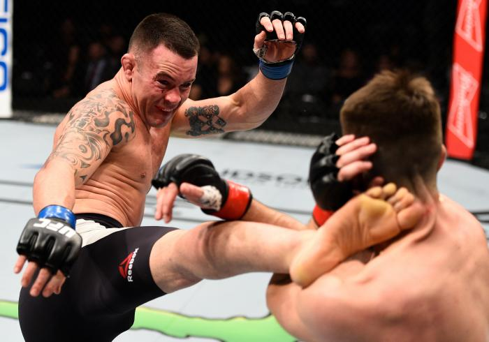 SACRAMENTO, CA - DECEMBER 17:  (L-R) Colby Covington kicks Bryan Barberena in their welterweight bout during the UFC Fight Night event inside the Golden 1 Center Arena on December 17, 2016 in Sacramento, California. (Photo by Jeff Bottari/Zuffa LLC via Getty Images)